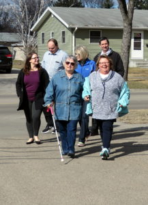 A gsmall group of walkers at walk for vision