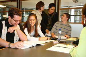 A group of students working together round a table.